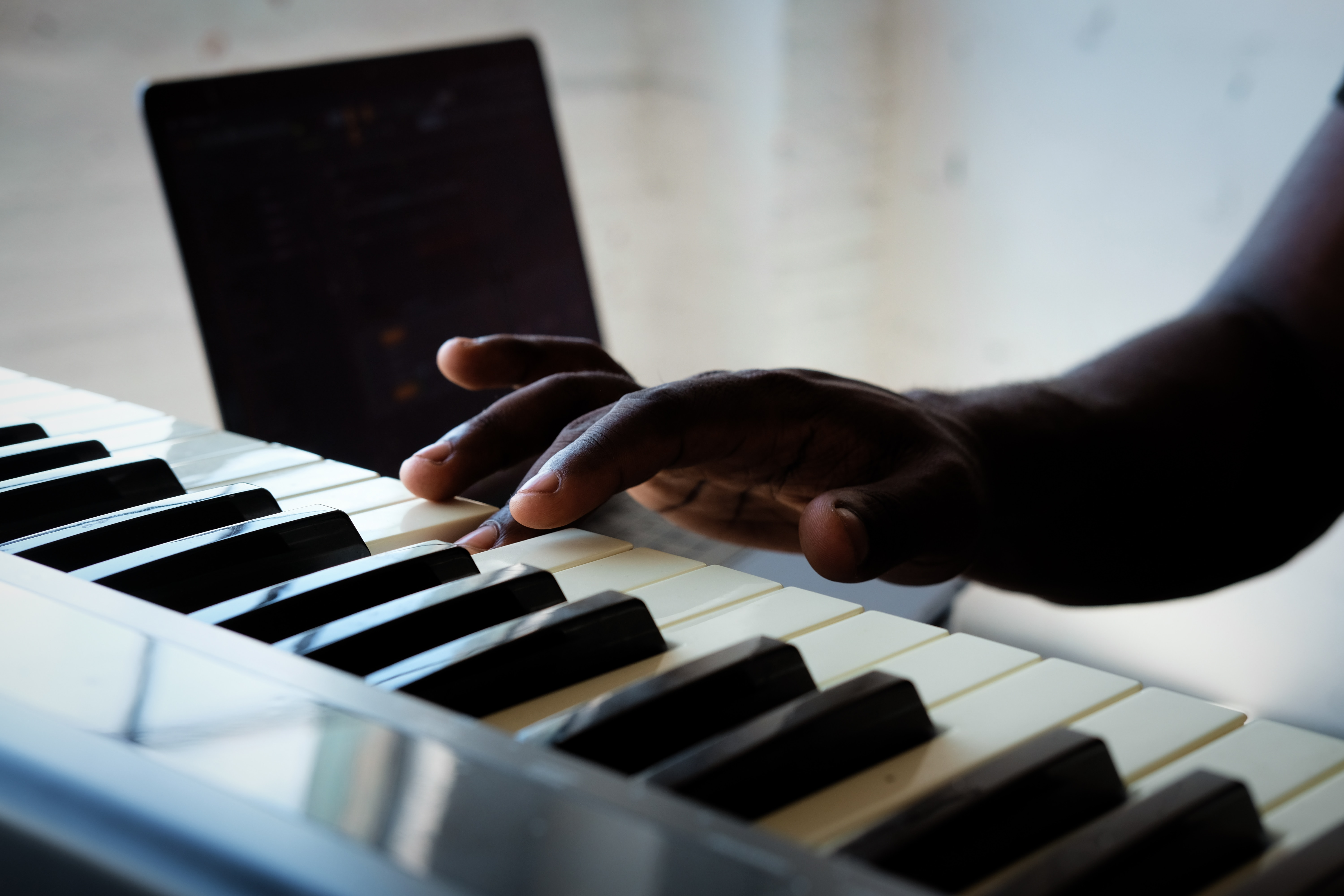 Close-up of a hand playing the piano. Playing a musical instrument can help motor skills and improve coordination.