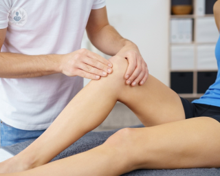 Specialist checking over a women's knee