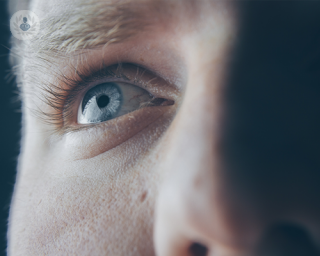 A man's blue eye and the surrounding area
