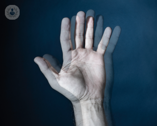 A person's hand out of focus, showing what diplopia looks like to people with this condition