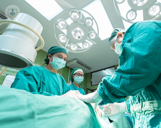 Three surgeons during a procedure