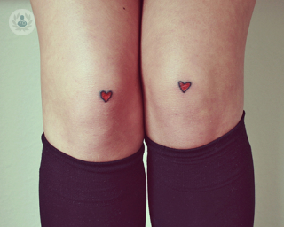 Knees with heart tattoos