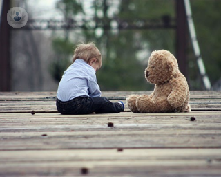 Child playing with teddy
