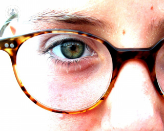 one eye with hipster glasses