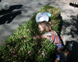Woman passed out in bush