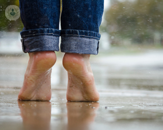 Feet tiptoeing in the rain