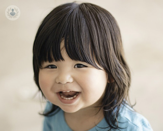really cute Asian kid smiling