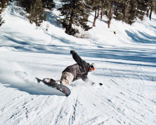 Man snowboarding down a slope