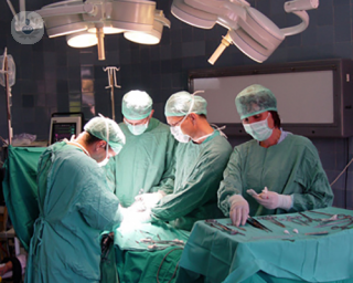 doctors performing surgery in theatre