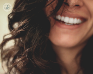 Woman smiling showing straight, white teeth