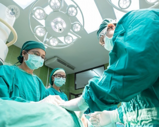 Surgeons performing surgery on a patient