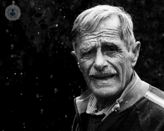 Black and white photo of an elderly man facing the camera