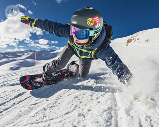 Snowboarder on the slopes. Snowboarding injuries can sometimes benefit from PRP treatment.