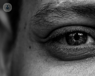 Black and white photo of a man's eye