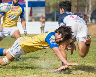 A rugby player tacking an opponent