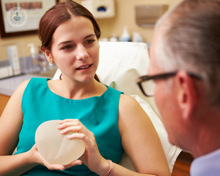 Patient and doctor discuss breast implants