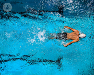Athlete swimming in a pool wearing a swimming cap