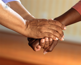 Two people hold hands to comfort each other. Liver cancer can be difficult to treat once diagnosed.