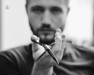 Man holding a pair of scissors