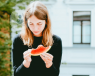 girl eating a slice of watermelon