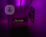 neon toilet sign with purple background