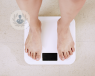 Two feet standing on a digital weight scale. Gastric sleeve surgery results in rapid weight change.