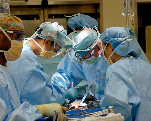 Surgeons standing around a patient during surgery
