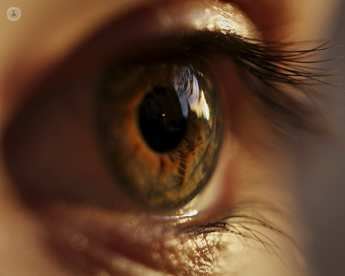 A macroshot of an eye. The person's eye is focusing on something in the distance.