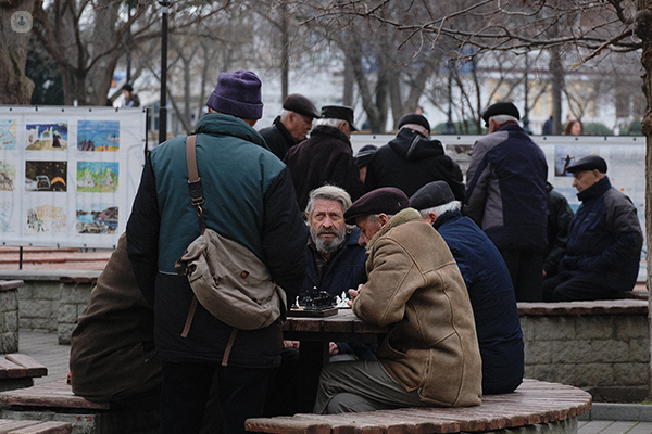 Group of old men at a table in a park